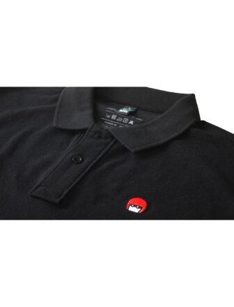 Polo negro con el logo michelin Xas bordado en el pecho
