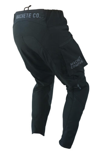 back view of black dirt bike pant with side pockets